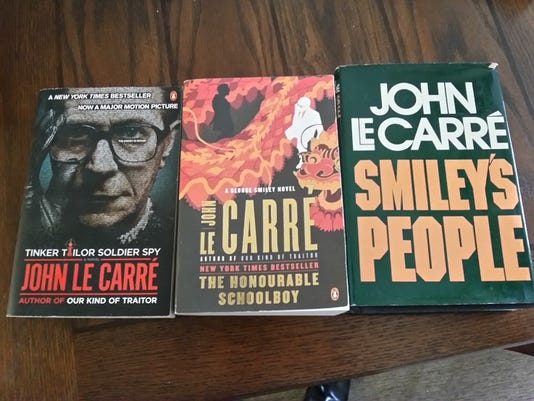 """From left, """"Tinker, Tailor, Soldier, Spy,"""" """"The Honourable Schoolboy"""" and """"Smiley's People"""" by John Le Carre. (Photo by Matt Eyer)"""