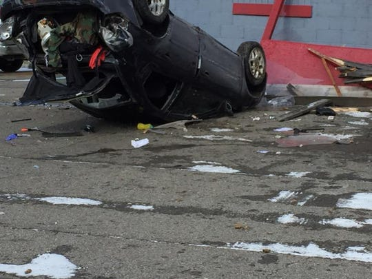 Police and rescue workers are at the scene of a crash at Greystone Lounge, 451 Grace St.