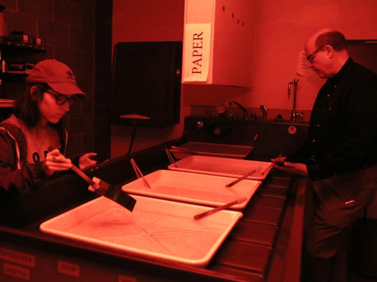 Del Mar College student Kimberly Garcia (left) and Fred Tinsley develop photos in a black and white darkroom on Monday, Dec. 5, 2016. A newly upgraded digital imaging lab, darkroom and studio includes 15 iMacs, Epson scanners, Canon Digital Rebel cameras and an Epson large format printer.