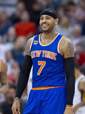 Carmelo Anthony reacts to being called for an offensive foul during the second half against the Utah Jazz at Vivint Smart Home Arena.