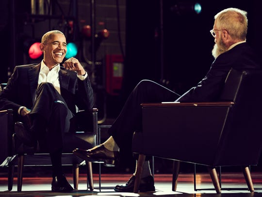 Former President Obama, left, speaks to David Letterman on Letterman's new Netflix talk show, which premieres Friday.