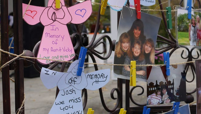 Notes, angles and photos hang in memory of friends and family who committed suicide. Staunton's Out of Darkness community walk at Gypsy Hill Park Saturday Oct. 10, 2015.