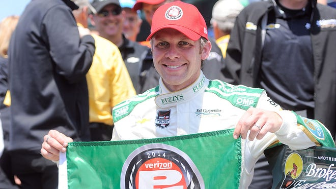 IndyCar Series driver Ed Carpenter celebrates after winning the pole of the 2014 Indianapolis 500 at Indianapolis Motor Speedway.
