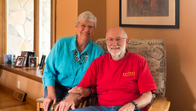 Marcia and Paul Fisher in their living room. Paul rebuilt and finished the 100 year old Morris chair; Marcia upholstered it.