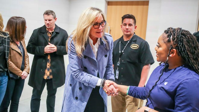 Angela Ahrendts, Apple's Senior Vice President of Retail, makes an appearance at Chicago's Michigan Avenue Apple Store after an Apple's education-focused event at Lane Technical College Preparatory High School.
