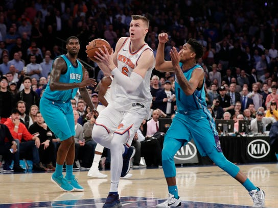 FILE - In this Nov. 7, 2017, file photo, New York Knicks' Kristaps Porzingis (6) drives past Charlotte Hornets' Malik Monk (1) to score during the second half of an NBA basketball game, in New York. Carmelo Anthony returns Saturday to find a Knicks team that's moved on just fine without him, riding Porzingis' play to a better record than Anthony's Oklahoma City squad. (AP Photo/Frank Franklin II, File)