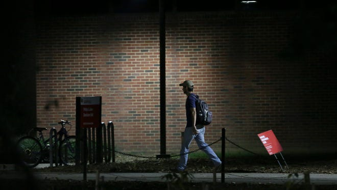 University of Louisville students often walk along this path outside Davidson Hall on the Belknap campus after dark.  Campus security is becoming more of an issue lately.