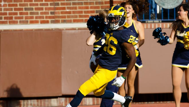 Michigan cornerback Jourdan Lewis scores a touchdown on an interception against the Northwestern Wildcats at Michigan Stadium.