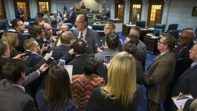 David Long, Indiana Senate president pro tempore, talks Feb. 2, 2016, at the Statehouse with media members about Senate Bill 344, which generated vigorous debate about civil protections for the lesbian, gay, bisexual and transgender communities.