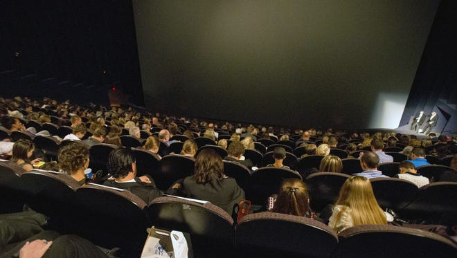 """A capacity crowd for the premiere of """"Livin' Like Hendrix,"""" a documentary about Hendrix Ebert, 8, who struggles with chronic pulmonary disease, at the IMAX at Indiana State Museum, Indianapolis, Sunday, Nov. 15, 2015."""