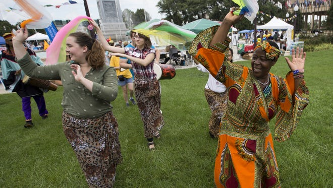 A parade kicks off Indy's Festival of Faiths in Downtown Indianapolis on  Sunday, Sept. 18, 2016.