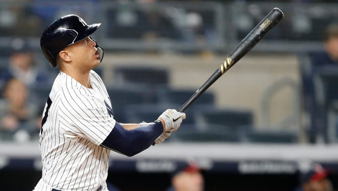 New York Yankees designated hitter Giancarlo Stanton watches his fifth-inning, solo home run.