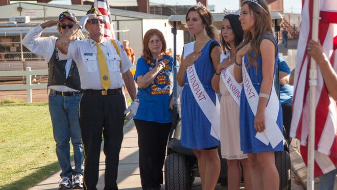 Members of the American Legion and the Washington County royalty during the flag raising ceremony at the beginning of the Washington County Fair Wednesday, Aug. 12, 2015.