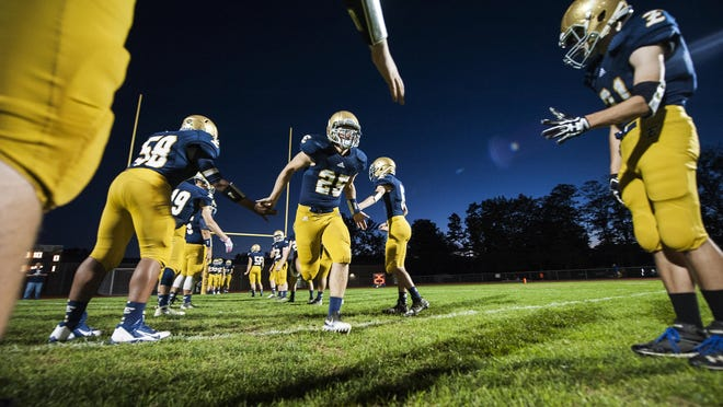 Essex senior Liam Coulter (25) takes the field as Essex honors their seniors during the high school football game between the Middlebury Tigers and the Essex Hornets at Essex High School on Friday night Octoer 7, 2016 in Essex.