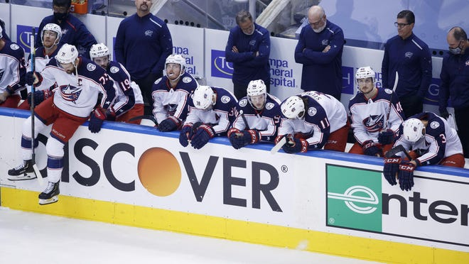 The Blue Jackets react on the bench after losing in overtime in the series-ending game Wednesday against the Lightning.