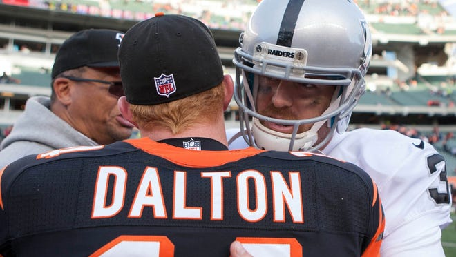 Carson Palmer and Andy Dalton exchange words after their first meeting in 2012.