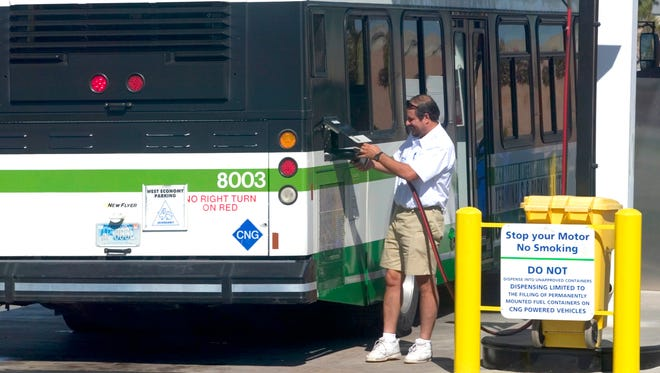 An airport bus driver fills up his bus at the Energy East CNG Fuel Site at the Sky Harbor Airport.  Maricopa County leads the nation in the use of alternative fuels.