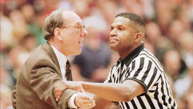 Syracuse head coach Jim Boeheim is restrained by official Ted Valentine after complaining about a call during the second half against Connecticut Sunday, Feb. 12, 1995, in the Carrier Dome at Syracuse, N.Y. Conecticut won 77-70.