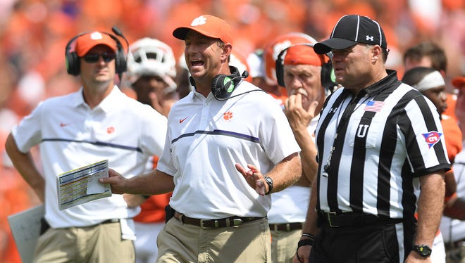 Clemson head coach Dabo Swinney reacts as officials review wide receiver Ray Ray McCloud's fumble against Troy during the 2nd quarter on Saturday, September 10, 2016 at Clemson's Memorial Stadium.