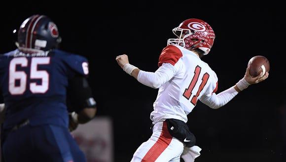 Greenville quarterback Davis Beville (11) passes against Belton-Honea Path on Friday, November 27, 2017.