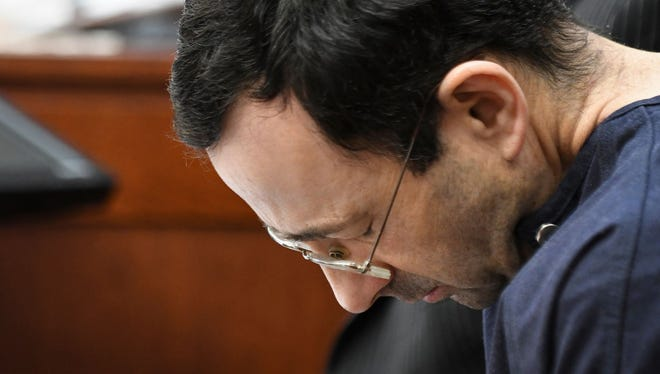 Larry Nassar hangs his head as former gymnast Amanda Thomashow gives her victim statement Tuesday, Jan. 23, 2018, during the sixth day of victim-impact statements in Ingham County (Mich.) Circuit Court.