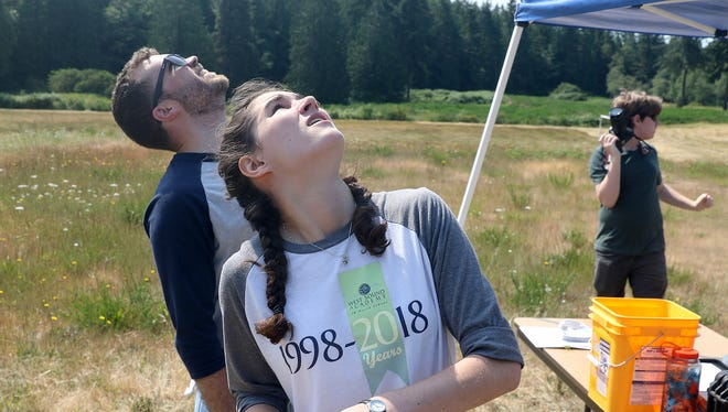 "West Sound Academy in Poulsbo eighth-grader Olivia Morningstar, 14, watches her rocket fly into the air after pressing the launch button on Wednesday. She is taking rocketry as part of the school's ""June Term."" The class is taught by teacher Spencer Tryba."