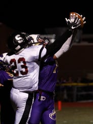 Kirtland Central's Jordan Heslop intercepts the a pass