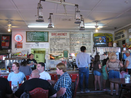 Travelers crowd into Rosie's Den, north of Kingman, hungry for homemade food and lucky lottery tickets.
