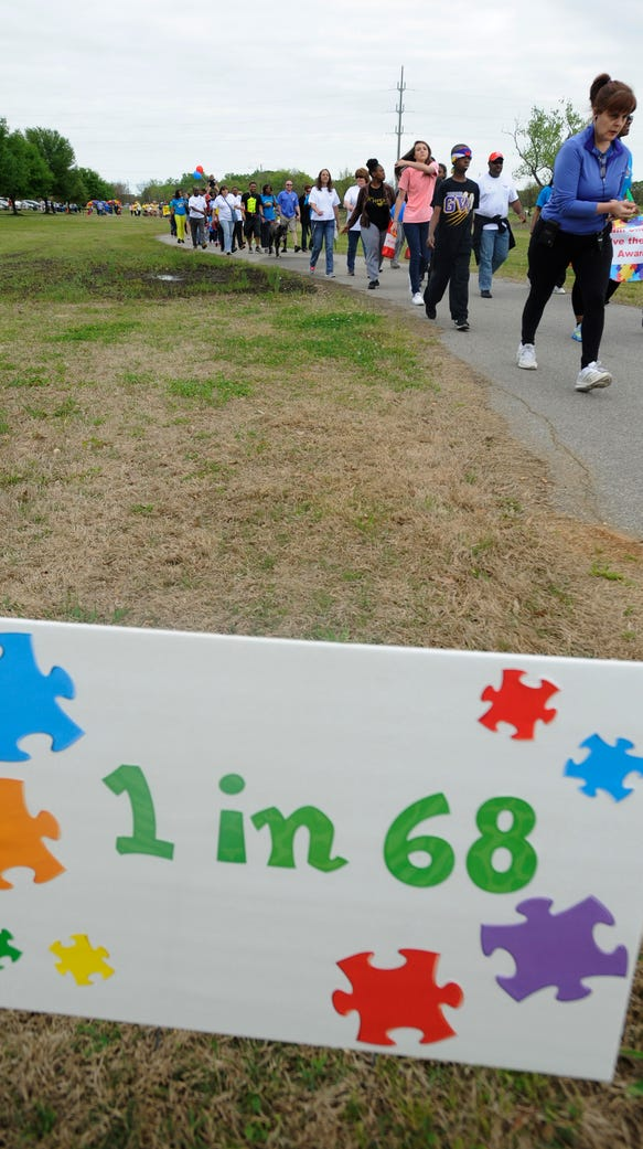 People take part in the Walk for Autism at Ida Bell