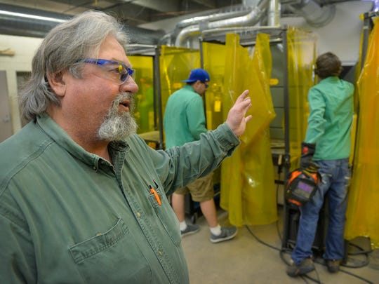 Instructor AJ Lerum talks April 21 about the Kimball High School welding equipment while students work in the classroom. Students at Kimball can get experience with oxygen/acetylene, wire feed, and arc welders.