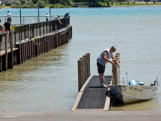 A man prepares his boat to be picked up on a trailer Wednesday, June 24, 2015 at the boat launch near Chrysler Beach in Marysville. New handicapped bathrooms, a snack shop, fish cleaning station and picnic area and other improvements will be coming to the park this summer.