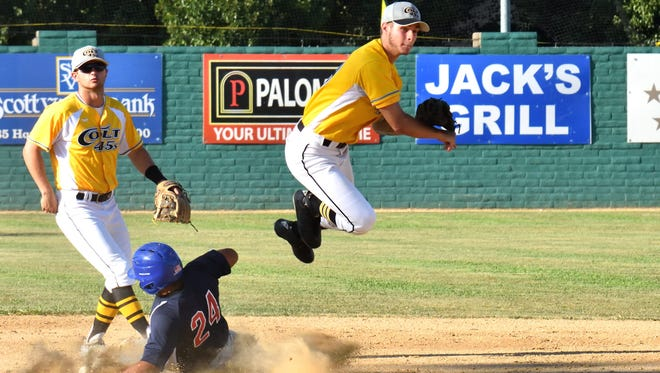 The Colt 45s' Austin Lively leaps over Fairfield's Jo Jo Quintanilla to complete a second-inning double play. Taylor Angley is shown in the background.