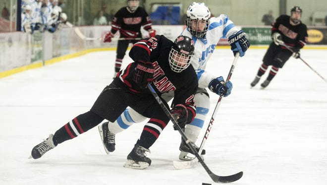 Rutland's Bauer Hill (24) skates past South Burlington's Max McDowell (2) with the puck during the boys hockey game between the Rutland Raiders and the South Burlington Rebels at Cairns Arena on Saturday.