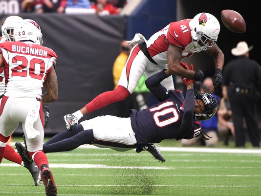 Arizona Cardinals strong safety Antoine Bethea (41) breaks up a pass intended for Houston Texans wide receiver DeAndre Hopkins (10) during the first half of an NFL football game, Sunday, Nov. 19, 2017, in Houston. (AP Photo/Eric Christian Smith)