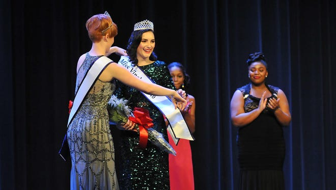Alyssa Rodriguez (right) is crowned Miss Vineland 2016 by Jaclyn Kell Miss Vineland 2015, Sunday, Jan. 31 at Landis Theater in Vineland.