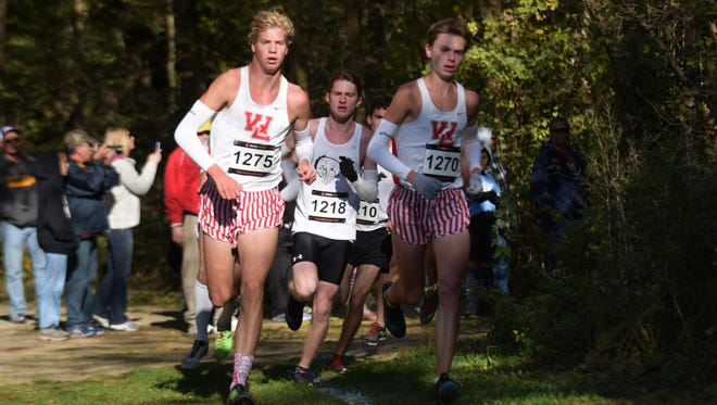 West Lafayette's Cooper Williams, left, and Evan Johnson work to maintain their lead halfway through the course during the Harrison boys cross country regional Saturday at the Tippecanoe Amphitheater.