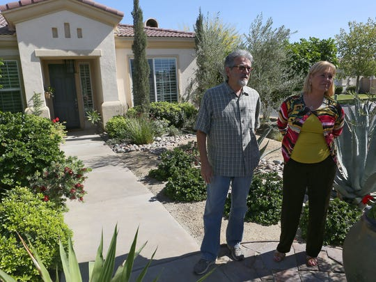 Sharon and Richard O'Donnell discuss their water usage outside their La Quinta home.