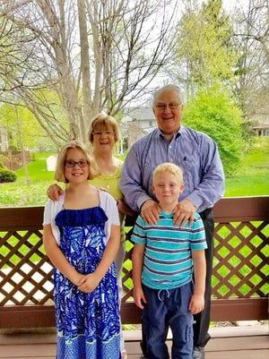 Jim Gurzynski and wife Kathy with two of their grandchildren.