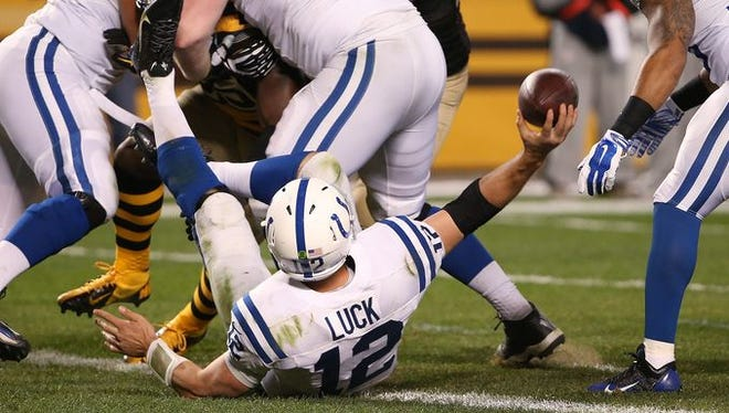 Indianapolis Colts Andrew Luck tries to pass after tripping and falling into the end zone in the fourth quarter on a play that was ruled a safety. Indianapolis traveled to Pittsburgh Sunday, October 26, 2014.