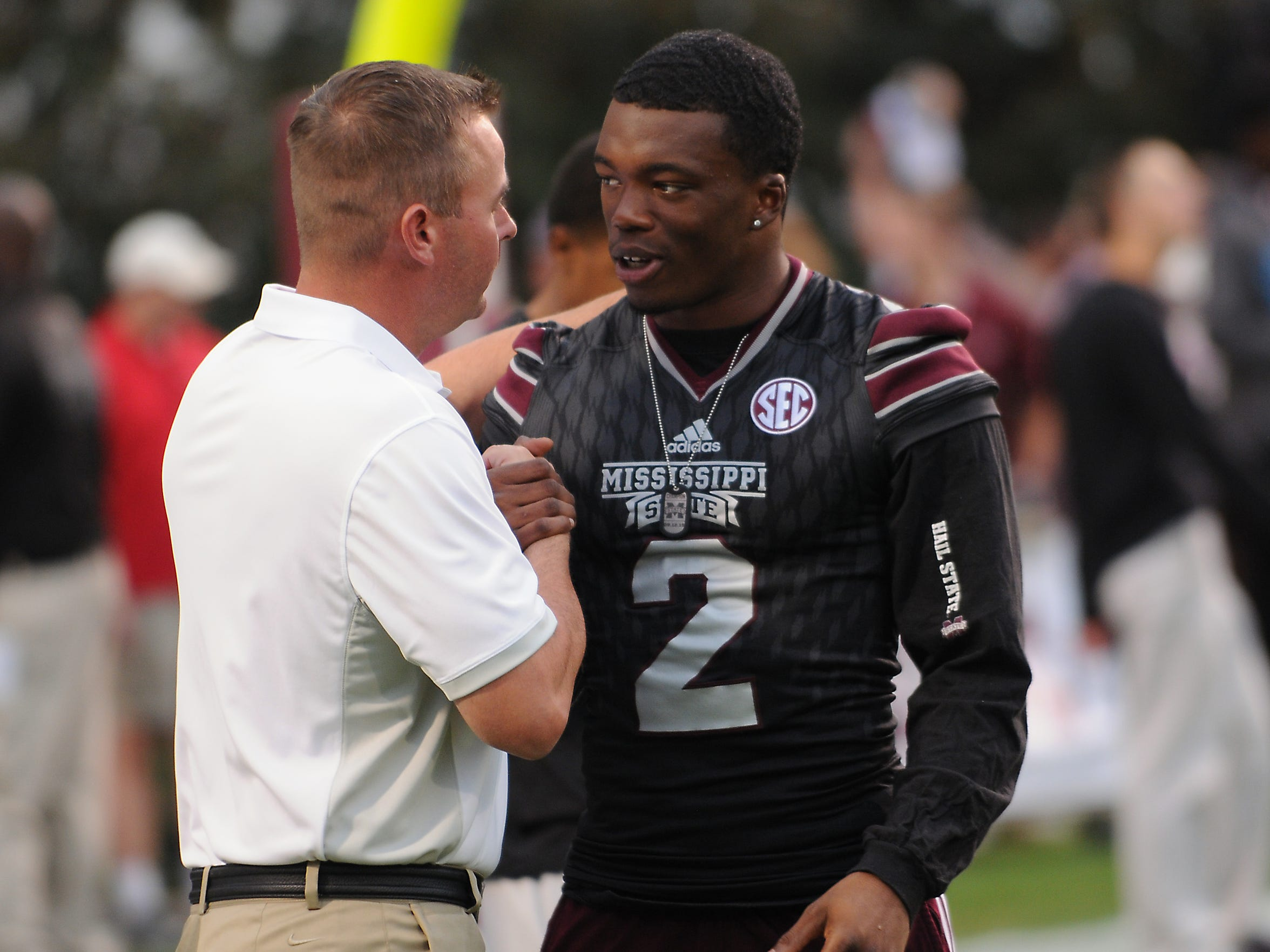 Kentucky Assistant Coach Tommy Mainord, left, speaks to Mississippi State defensive back Will Redmond before their game Saturday.