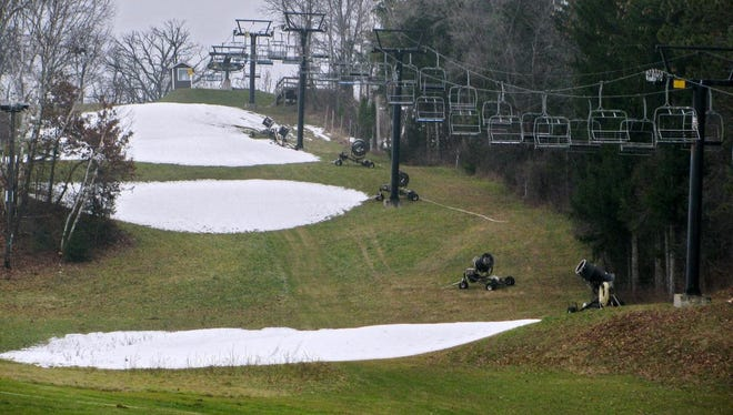 In this Tuesday, Dec. 8, 2015 photo, the ski hills at Tyrol Basin are seen near Mount Horeb, Wis. Warm weather in December has meant an extended season and extra revenue for golf courses in the Madison, Wis., area. But the balmy start to the season has ski hill operators in Wisconsin worried. (Rob Schultz/Wisconsin State Journal via AP) MANDATORY CREDIT