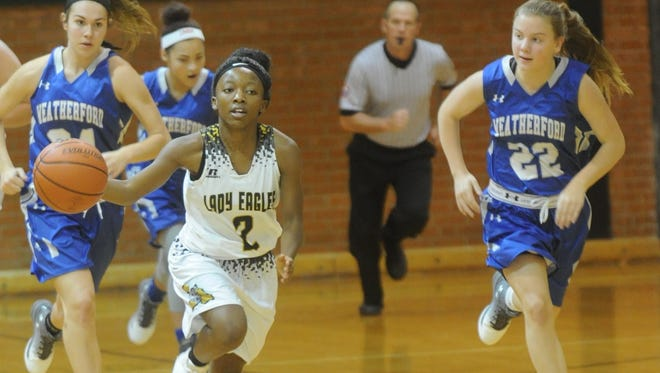 Abilene High's Sandrine Tuyizere (2) pushes the ball upcourt as Weatherford's Grace Clark (22) defends. The  Lady Roos beat AHS 66-42 in the third-place game of the Polk-Key City Classic on Saturday, Nov. 19, 2016 at Eagle Gym.