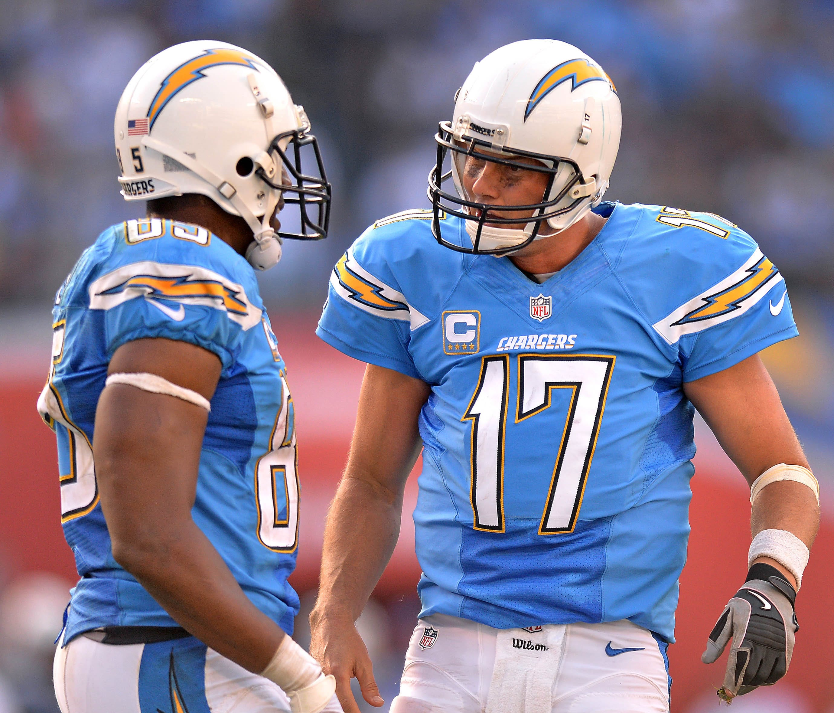 Chargers quarterback Philip Rivers (17) talks to tight end Antonio Gates (85) during the third quarter against the Tennessee Titans at Qualcomm Stadium.
