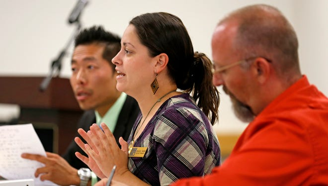 Associated Students of San Juan College President Jessica Valdez answers questions on Monday during a meeting at San Juan College in Farmington.