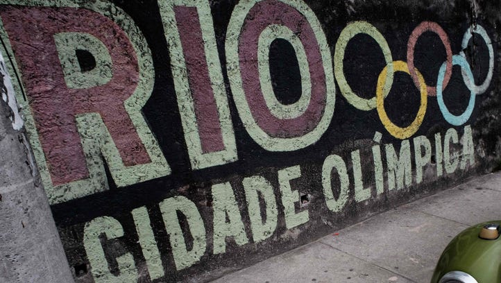 A graffiti with the logo of the Olympic Games on a wall of Rio de Janeiro on June 4.