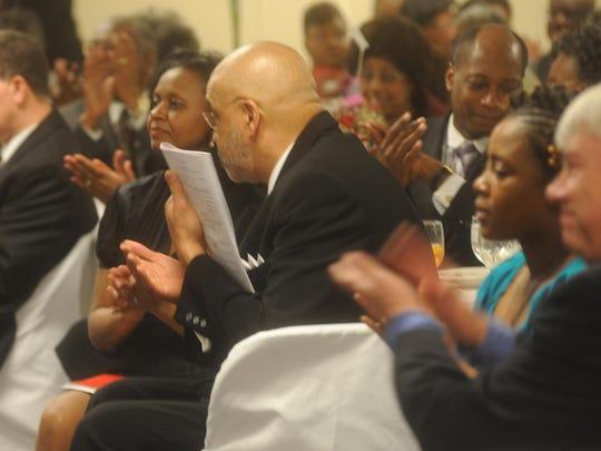 Audience members applaud for the Fisk Jubilee Singers