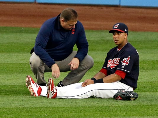 Cleveland Indians' Michael Brantley, right, is looked at by a trainer in the fifth inning of a baseball game against the Colorado Rockies, Tuesday, Aug. 8, 2017, in Cleveland. Brantley left the game in the fifth inning. (AP Photo/Tony Dejak)