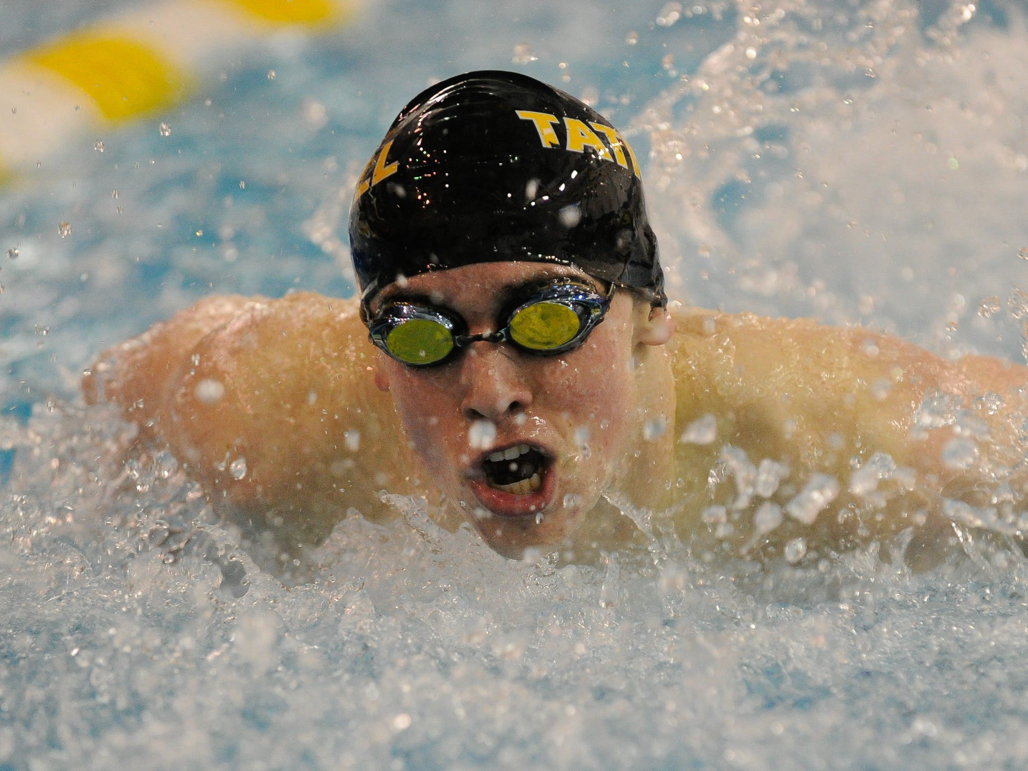 Tatnall's David Crossland sets a state record in winning the 100-yard butterfly at the state meet on Feb. 28.
