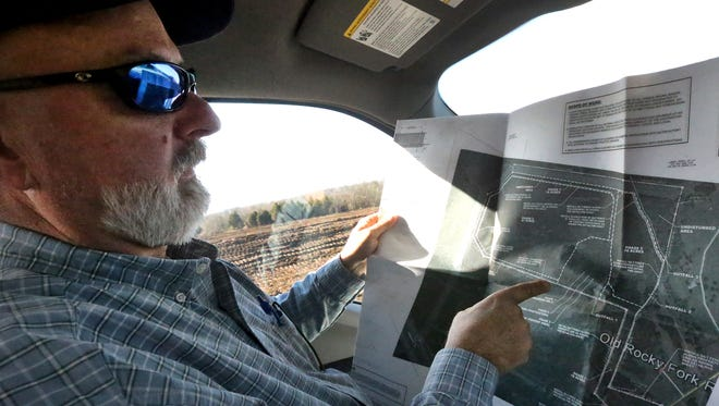 Trey Lee, the Rutherford County project manager, Tuesday, Jan. 12, 2016, shows a map of the property where the land is being cleared for the site of two county schools at the Rocky Fork Road property in Smyrna.