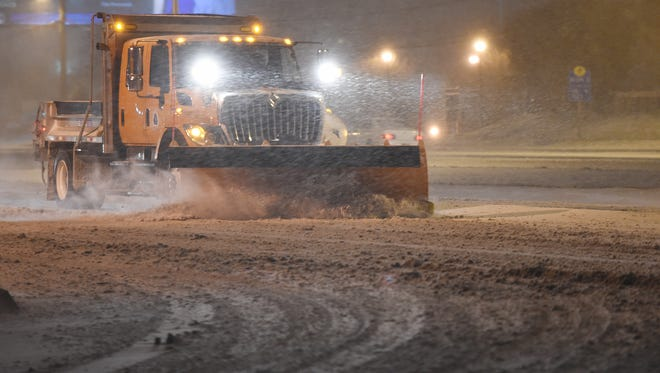 A DelDot plow moves down Coastal Highway as Snow continues to fall as a winter storm starts to bare down on the Delaware Coastal area on Friday January 22nd.